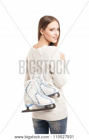 young woman with pair of ice skates isolated
