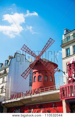 Paris - JULY 8, 2013:  Moulin Rouge Cabaret famous red mill on July 8 in Paris, France. Moulin Rouge Cabaret is the famous cabaret theatre in Paris since 1889
