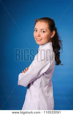 Studio portrait of young intern against blue backgound