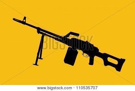 Silhouette of machine gun on yellow