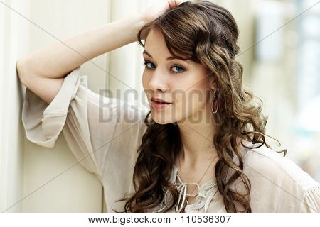 Portrait of beautiful young happy woman in disco grey dress, indoor
