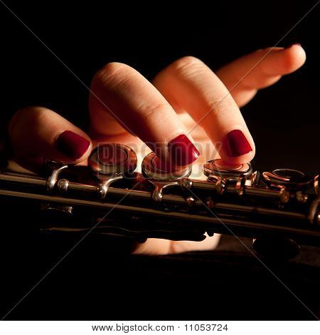 Young Woman Playing Flute
