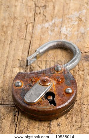 Open Antique Padlock On Wooden Board