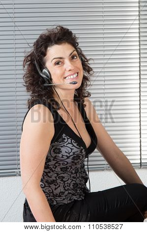 Smiling  Woman With Headphone Isolated Against Gey Background