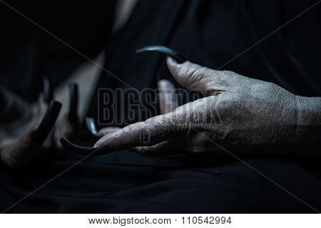 Wrinkled Hands With Long Fingernails