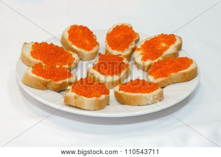 Sandwiches with red caviar.