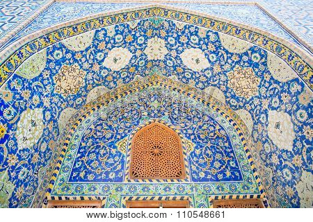 Beautiful Ceramic Tile With Persian Patterns In The Niche With Window Of A Historic Building In Isfa