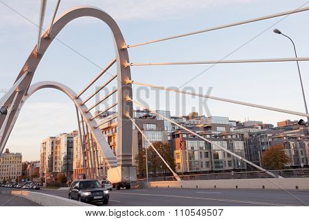 ST. PETERSBURG, RUSSIA - OCTOBER 16, 2015: Traffic on the Lazarevsky bridge across the Small Nevka River. New cable-stayed bredge was built in 2009 instead of old wooden bridge