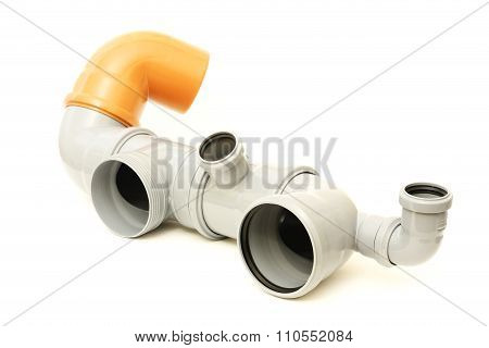 New gray and brown drain pipe, isolated on white