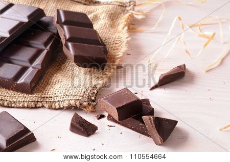 Broken Tablet Artisan Chocolate On Wooden Table Elevated View