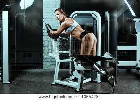 Woman On The Machine For Bodybuilders Doing Exercise.