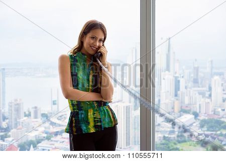 2 Young Latina Businesswoman With Wired Telephone In Modern Office