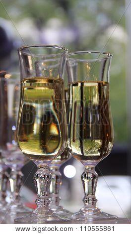 Glasses of white wine closeup