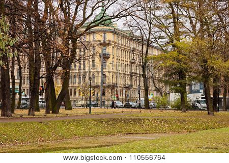 ST. PETERSBURG, RUSSIA - NOVEMBER 4, 2015: Tavrichesky Garden and the Shulgin's apartment house in autumn day. The building was erected in 1909 by design of M. I. von Wilcken