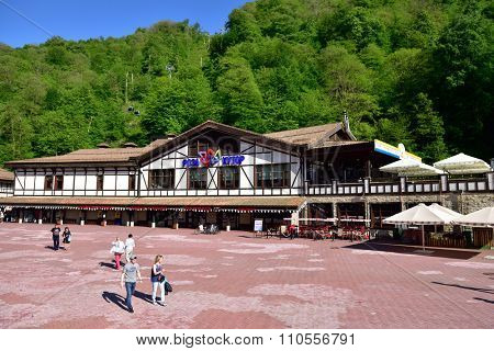SOCHI, RUSSIA - MAY 18, 2015: People in the Rosa Khutor ski resort. Built in 2003-2014, it is the only resort in Russia hosting both summer and winter mountain sports in convenient and safe conditions