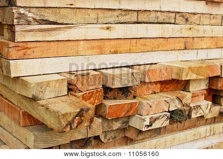 Stack Of Lumber In Logs Storage Closeup