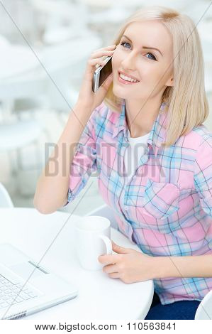 Pleasant woman sitting in the cafe