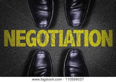 Top View of Business Shoes on the floor with the text: Negotiation