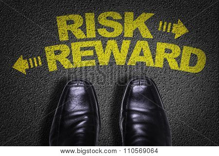 Top View of Business Shoes on the floor with the text: Risk - Reward
