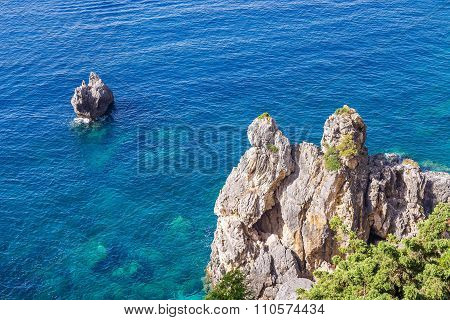 Gray Rocky Coast And Blue Sea Or Ocean