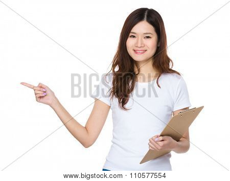Asian Young Woman hold with document work and finger point up