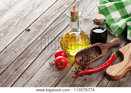 Spices and condiments on wooden table. View with copyspace