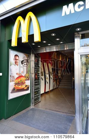 BARCELONA, SPAIN - NOVEMBER 20, 2015: entrance to McDonald's restaurant. McDonald's is the world's largest chain of hamburger fast food restaurants, founded in the United States.