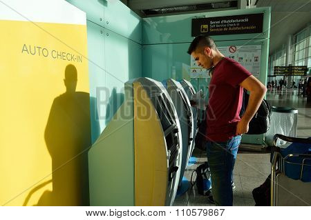 BARCELONA, SPAIN - NOVEMBER 20, 2015: passenger use check-in kiosk in Barcelona airport. Barcelona-El Prat Airport is an international airport. It is the main airport of Catalonia.