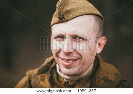 Smiling unidentified re-enactor dressed as Soviet soldier in cam