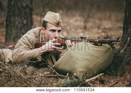 Unidentified re-enactor dressed as Soviet russian soldier aiming