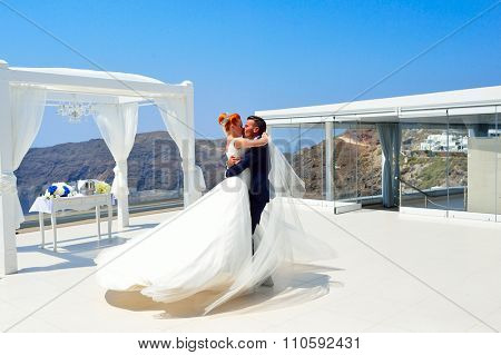 SANTORINI, GREECE - AUGUST 05, 2015: beautiful young couple bride and groom celebrate wedding on Santorini. Santorini island popular place for wedding celebrations