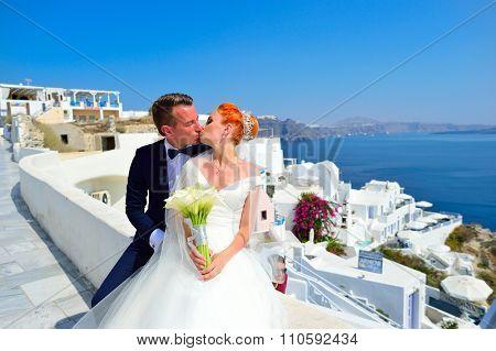 SANTORINI, GREECE - AUGUST 05, 2015: beautiful young couple bride and groom celebrate wedding on Santorini. Santorini island popular place for wedding celebrations