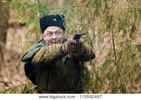 Unidentified re-enactor dressed as Soviet russian soldier firing