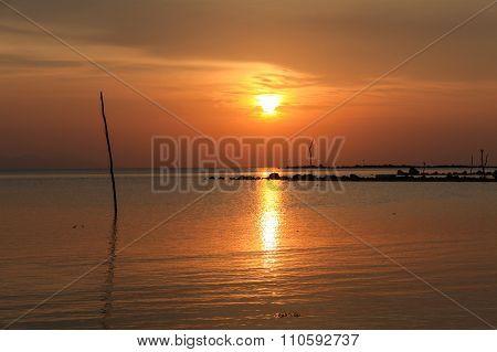 Calm Sea And Sky During Sundown.