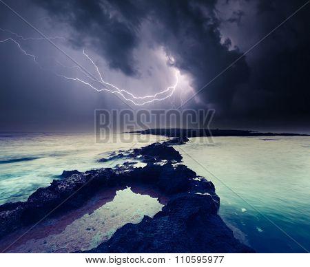 Dark ominous clouds. Thunderstorm with lightning. Volcanic island of Malta. Qawra, Europe. Beauty world.