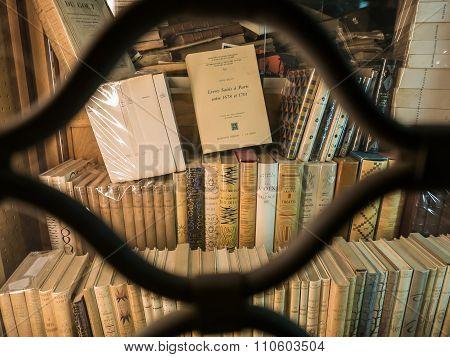 Paris Bookshop At Night Through Security Gate