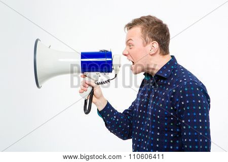 Profile of angry crazy man in checkered shirt shouting in megaphone over white background