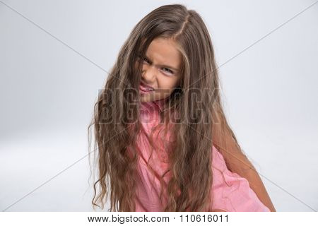 Portrait of a little girl fooling around isolated on a white background