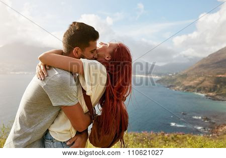 Loving Young Couple Embracing Outdoors