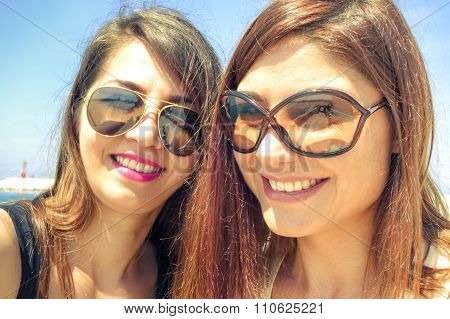 Women couple taking selfie and smiling on summer vacation