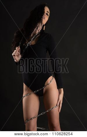 passionate woman in a bodysuit with a chain