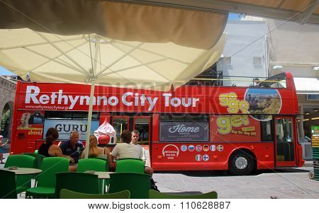 City Tour Bus And People In Old Town Of Rethymno, Crete, Greece.