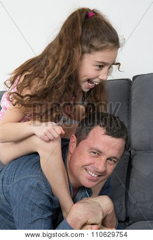 Portrait Of A Man And A Girl On Sofa