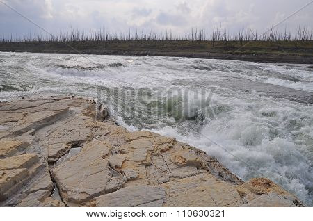Turbulent Rapids On The River.