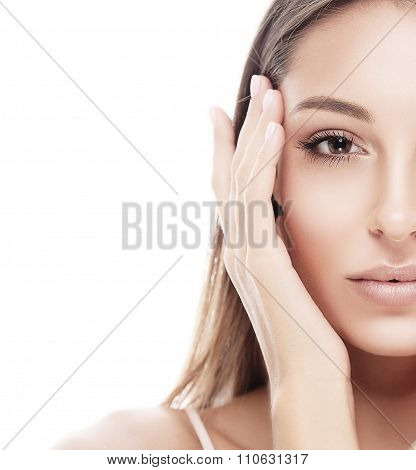 Beautiful woman half face studio on white with sexy lips isolated on white  touching its face