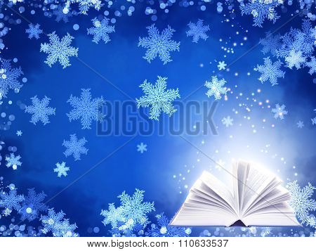 Horizontal Christmas background of blue color with magic book and snowflakes