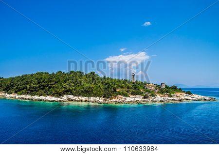 Old Venetian Lighthouse Of Port Fiskardo On Kefalonia Island, Greece.