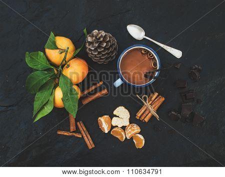 Christmas or New Year items. Fresh mandarins with leaves, cinnamon sticks, vanilla, pine cone and mu