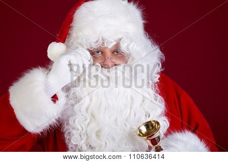Santa Claus ringing a bell, it's Christmas time,
