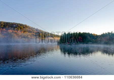 Sunrise Above Forest Lake